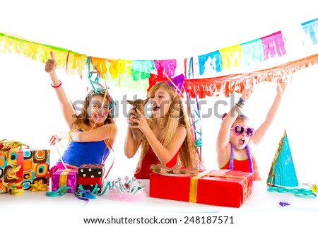 girl friends party dancing with presents and puppy chihuahua dog in birthday - stock photo