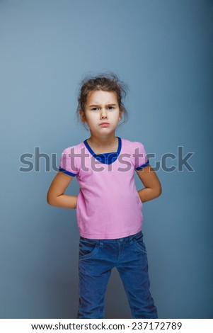 girl frowned looking at the camera - stock photo