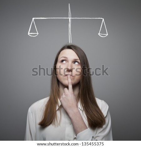 Girl full of doubts and hesitation - stock photo