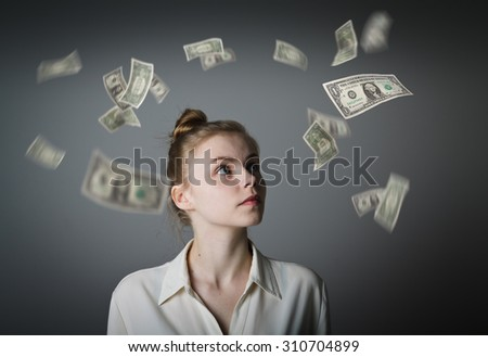 Girl full of doubts and hesitation. Money in motion. Young slim woman. - stock photo