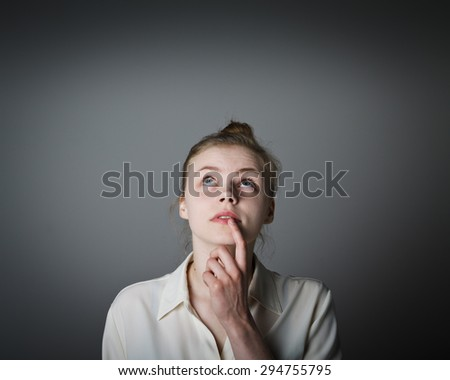 Girl full of doubts and hesitation. Young slim woman. - stock photo