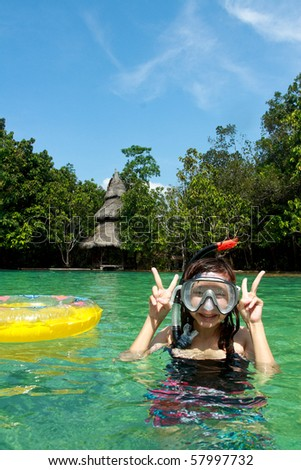 Girl funny in the Emerald Pool Location attractions in Thailand.