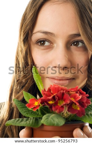Girl gave the vase with flowers and she was glad gift - stock photo