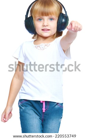 girl gesturing with his hands while listening to music on headphones, isolated on white background.The concept of development of the child, the child's upbringing. - stock photo