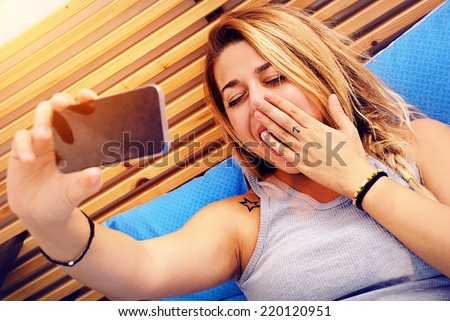 Girl gets a photo to herself while she yawning - stock photo