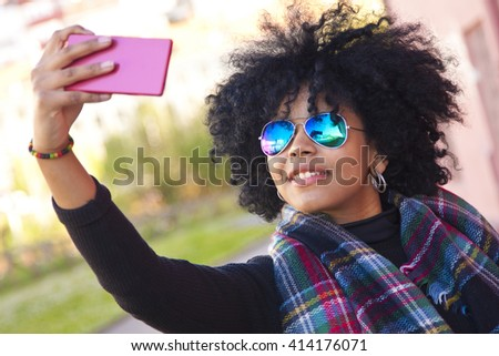 girl getting a selfie on street