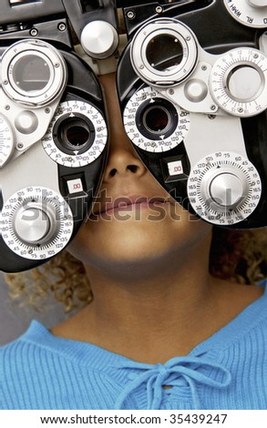 girl getting eyes testing - stock photo