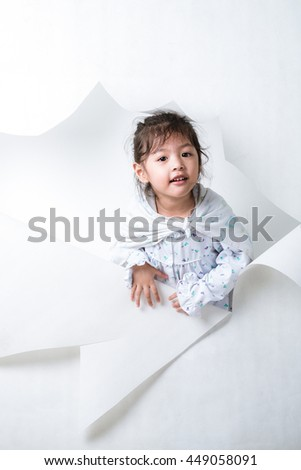 Girl Getting Out From a Hole on White Background