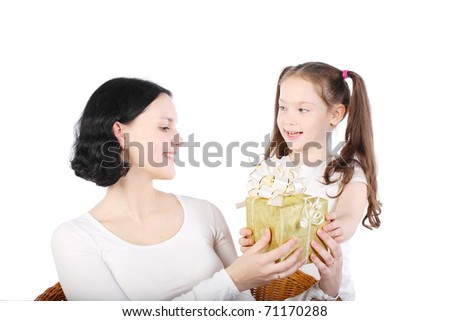 girl gives to mum a gift. It is isolated on a white background