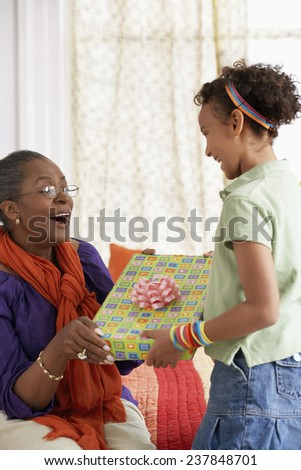 Girl Giving Grandmother a Gift