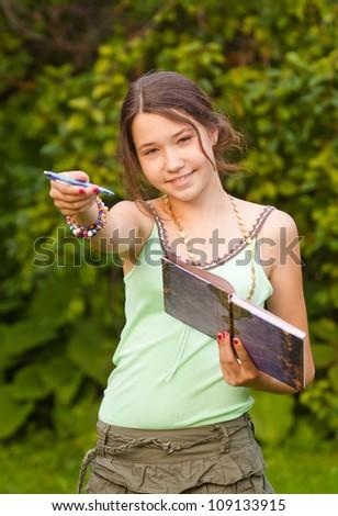 Girl giving pen - stock photo