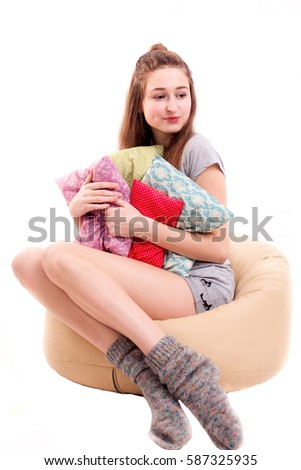 Girl go to sleep with a lot of pillows isolated on white