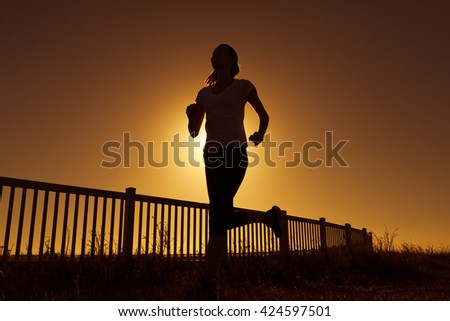 Girl going for a early morning run.  - stock photo