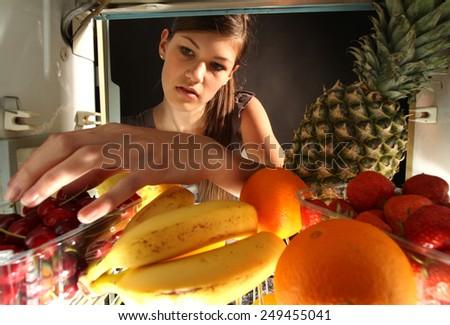 Girl grabbing food  - stock photo