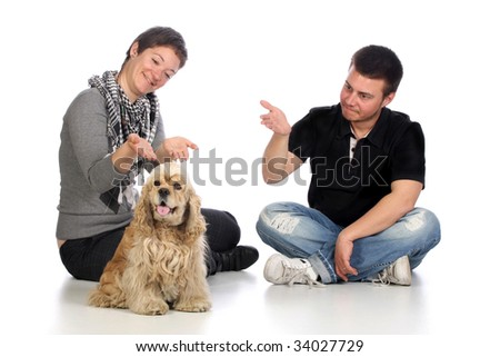 Girl, guy and american cocker spaniel over a white background - stock photo