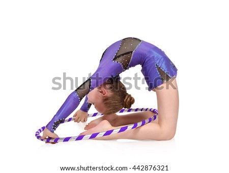 girl gymnast in blue clothes posing with hula hoop - stock photo