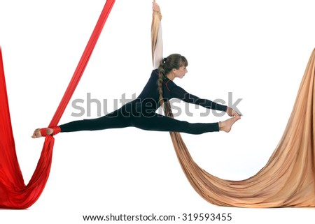 girl gymnast on aerial silk isolated on white background studio