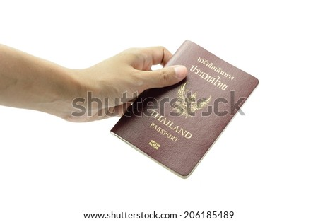 girl hand holding old thailand passport book isolated on white background