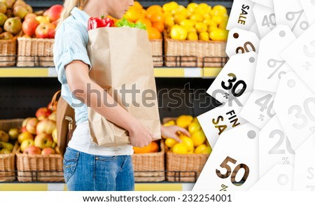 Girl hands bag with fresh vegetables choosing lemons at a good price - stock photo