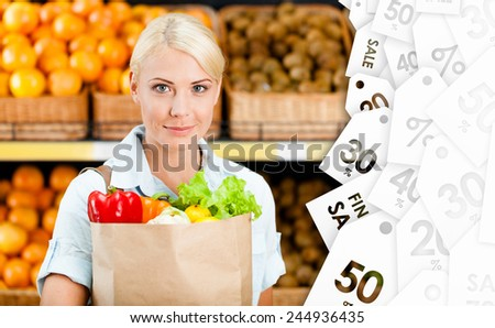 Girl hands bag with fresh vegetables. Offer of the day in the shop - stock photo