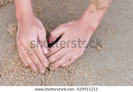Girl Hands Playing Sand on the Beach