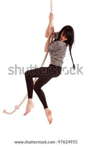girl hanging on a rope - stock photo
