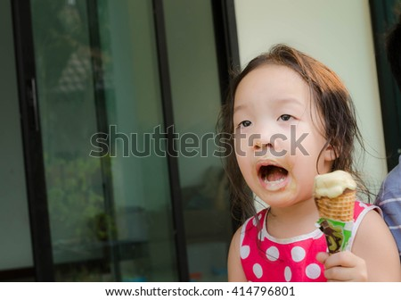 girl happy eating ice cream - stock photo