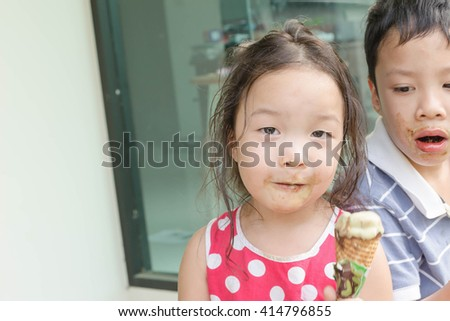 girl happy eating ice cream - stock photo