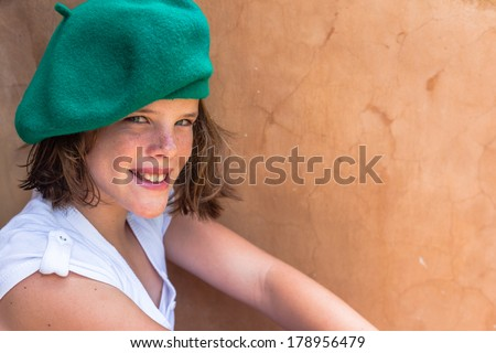 Girl Happy Smile Beret  Teen girl close portrait healthy,fit, moods, smile wearing green beret hat white top. - stock photo
