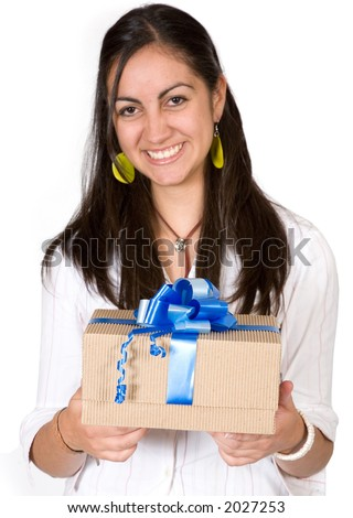 girl happy with her gift over a white background - focus is on the gift