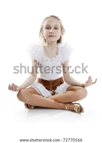 Girl has a relaxing in a pose of the meditating. On a white background - stock photo