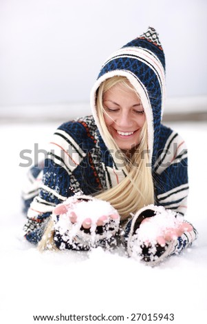 Girl has fun with snow in cold winter time - stock photo