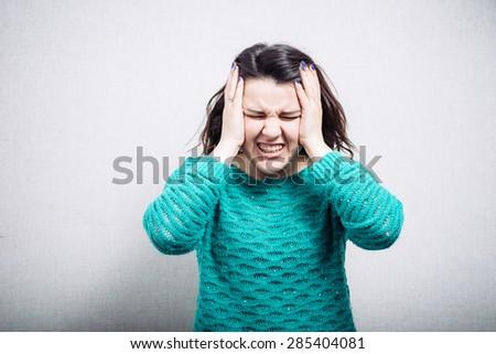 Girl has headache - stock photo