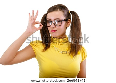 Girl has lifted thumb upwards, isolated on white background. - stock photo