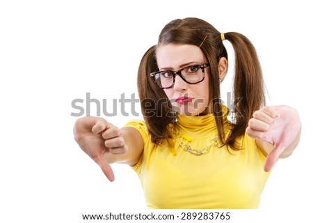 Girl has lowered thumb downwards, isolated on white background. - stock photo