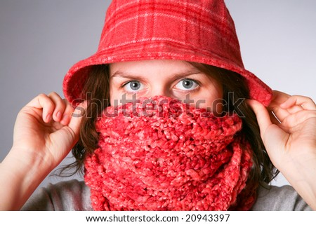 girl has muffled in a scarf. Cold.