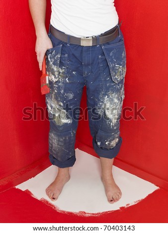 Girl has painted herself in the corner - stock photo