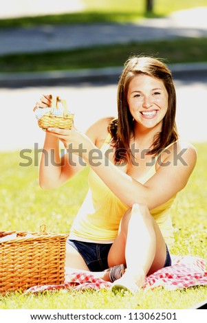 Girl having a pic nic in a park