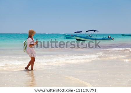 Girl having a walk in Playa Paraiso, Mayan Riviera, Mexico - stock photo