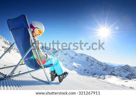 Girl having fun in ski resort - stock photo