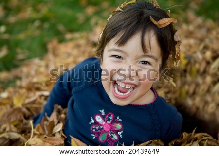 Girl Having fun in the Leaves - stock photo