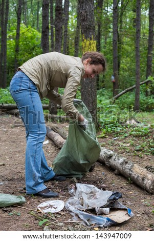 Girl helping clean up the forest in Elk Island National Park. - stock photo
