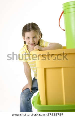 girl hiding behind pile of plastic containers