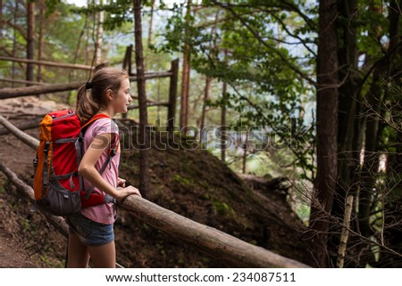 girl hiker on a path at the forest  - stock photo