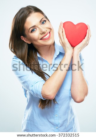 Girl hold red heart. Isolated white background studio portrait.