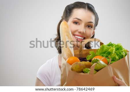 girl holding a bag of food - stock photo