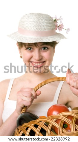 girl holding a basket of delicious fresh vegetables. - stock photo