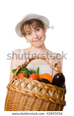 girl holding a basket of delicious fresh vegetables.