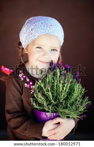 Girl holding a basket of lavender, close-up - stock photo