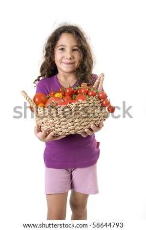 girl holding a basket of tomatoes isolated on white